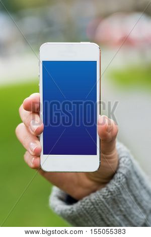 Woman Holding White Smartphone With Hand