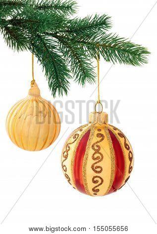 Set of gold balls hanging on tree. Isolated on white background.