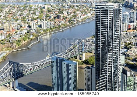 BRISBANE, AUSTRALIA - OCTOBER 18 2016: Brisbane riverwalk to New Farm and Story Bridge with surrounding cityscape, view from above.
