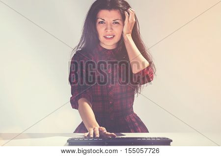 Confused Young Woman And A Keyboard