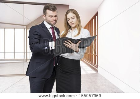 Businessman and his personal assistant are discussing project details in empty office corridor. Concept of collaboration. 3d rendering. Mock up