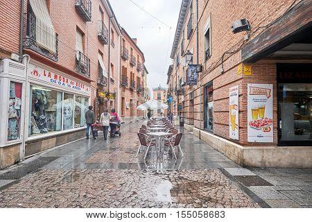 ALCALA DE HENARES, MADRID, SPAIN. November 5, 2016, Cervantes street in the rain