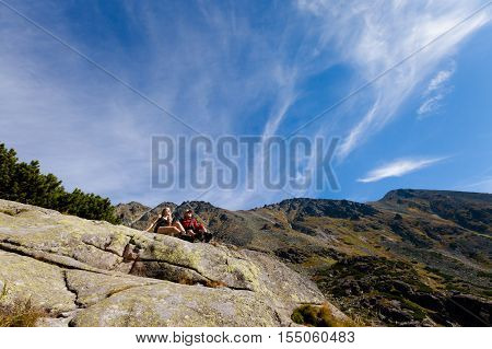 Tourists trekking in Beautiful Mlynicka dolina on the way to Bystre sedlo - in slovakian high Tatra mountains. Summer panorama with great weather and blue sky poster