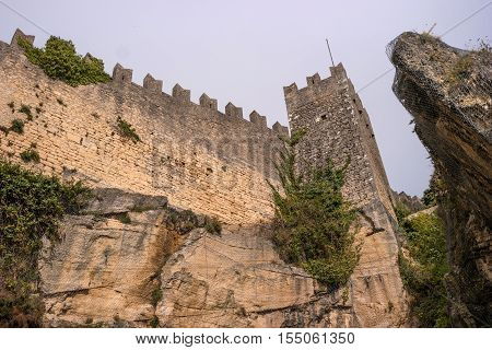 The woll of Guaita fortress is the oldest and the most famous tower on San Marino. Italy. Mount Titano gave place for the construction of the three most beautiful fortresses of San Marino.