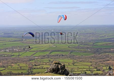 Paragliders flying wings above Dartmoor in Devon