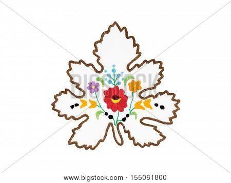 Hungarian embroidery with floral motives isolated on white background