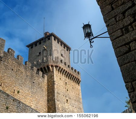 One of the three towers. The Republic of San Marino is a country in the Apennines. Street lamp close-up against the sky.