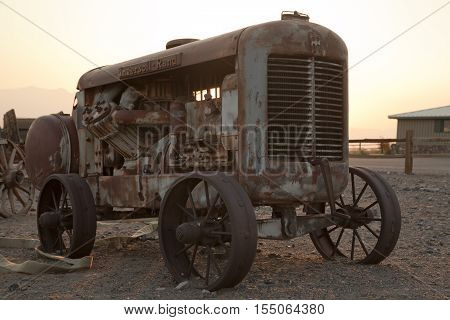Stovepipe Wells Village Death Valley California USA - August 24 2016: Abandoned tractor at Stovepipe Wells Village