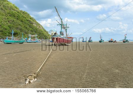 Long tail fisherman boat anchor at the beach