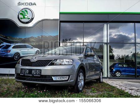 HAVIROV CZECH REPUBLIC - NOVEMBER 4: Grey Skoda Rapid liftback car in front of the car seller showroom in Havirov Czech Republic on November 4 2016.