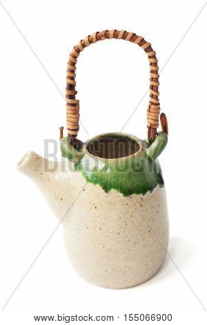 Lovely little Asian ceramic glazed teapot isolated on white. Cute tall green Japanese traditional tea pot with wicker handle