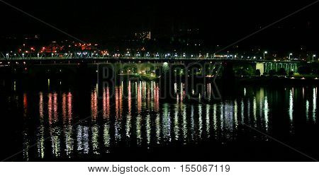 the Market Street Bridge in Chattanooga, Tennessee, crossing the Tennessee River, illuminated at night