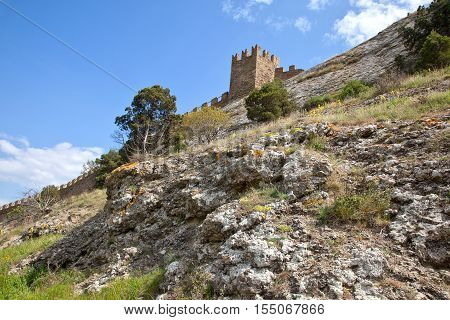 Crimea. Sudak. Territory of the ancient Genoese fortress. Wall with towers