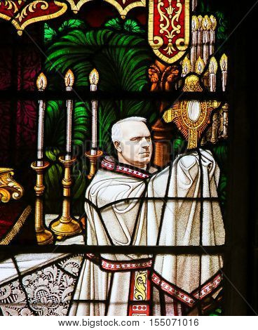 Stained Glass - A Bishop Holding A Monstrance