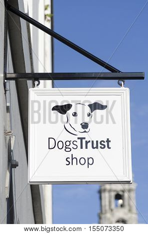 COLCHERTER HIGH STREET, ESSEX, ENGLAND, UK- 2 NOVEMBER 2016- A sign for the dog trust  Charity shop, where people can buy things to help dogs.