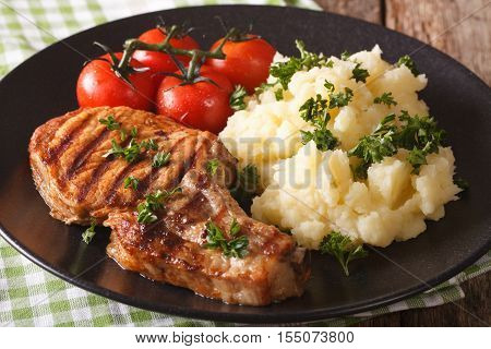 Grilled Pork Loin With Mashed Potatoes And Tomato Close-up. Horizontal