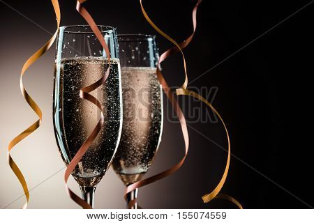 Two wineglasses with sparkling champagne and decorative ribbons