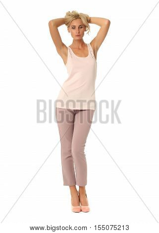 Blond Fashion Model Girl Stand In Pink Trousers Isolated