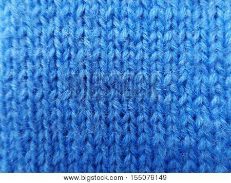 Blue knitted handmade background. Related facial loops. Warm mohair. Suitable for the decoration of any sites in winter and sites of creativity at any time of the year