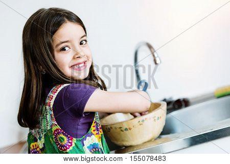 Very Cute Kid Doing Crockery