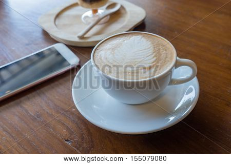 Cup Of Hot Coffee Ad Smartphone Put On Old Wooden Table Background