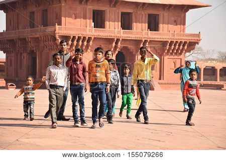 FATEHPUR SIKRI, UTTAR PRADESH, INDIA - FEBRUARY 05, 2016 - Unidentified group of indian kids walking in Fatehpur Sikri archaeological site