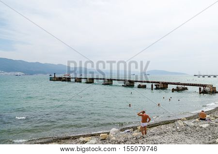Novorossiysk Krasnodar Krai Russia - August 28 2016. View from the embankment of the bay and a ruined pier.