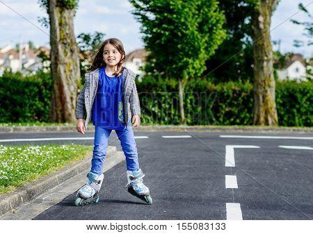 Little Girl Doing Rollerblade In The Street