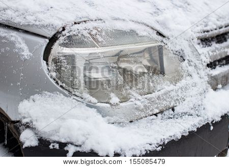 Car light in the winter. Snow. In the daytime