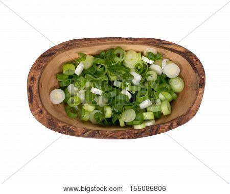 Organic green onion scallion in olive wood bowl on white background