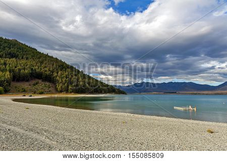 Tekapo New Zealand - February 2016: People swimming at at Lake Tekapo South Island of New Zealand