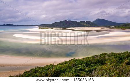 View from hill inlet lookout on Whitehaven beach at Whitsunday Island near Airlie Beach, Australia at low tide. The beautiful green color is very rare.