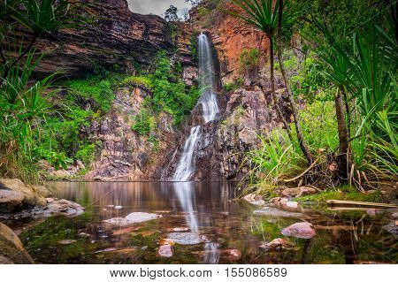 The Tjaynera Falls at Sandy Creek are among the least visited sights of Litchfield National Park in Australia's Northern Territory. The falls can only be reached by a 4x4 track and a walk. poster