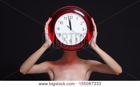 Woman holding a clock instead of a head.