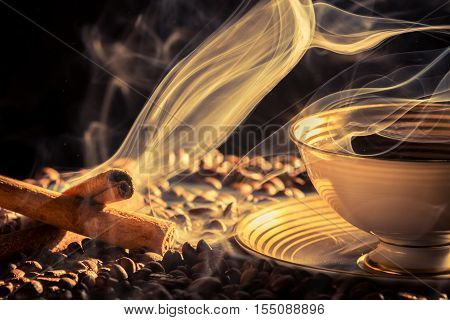 Cinnamon scent of roasted coffee on black background