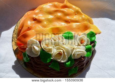 Cake with white roses on a white tablecloth