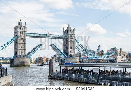 LONDON UK - AUGUST 21 2015: Tower Bridge open in London UK. English symbol. The bridge crosses Thames River close to the Tower of London and has become an iconic symbol of London