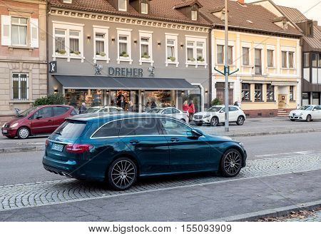 KEHL GERMANY - NOV 4 2016: Mercedes-Benz estate wagon car parked in center of typical German city. Mercedes-Benz is a global automobile manufacturer and a division of the German company Daimler AG. Mercedes-Benz E-Class Mercedes-Benz CLS-Class