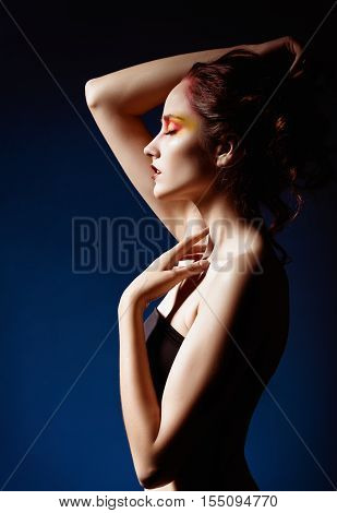 Portrait of a beautiful redhead girl. Profile view