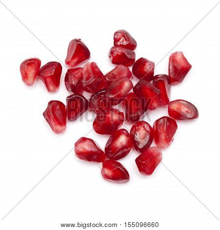 dark red ripe pomegranate seeds isolated on white