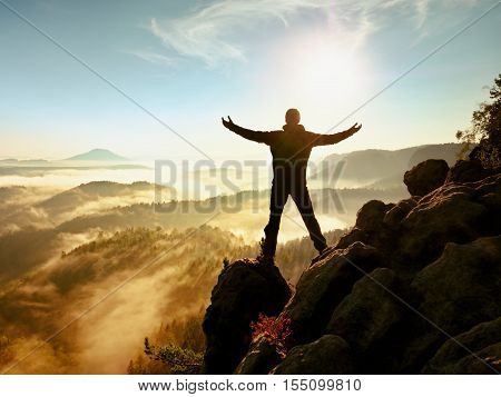 Sunny Fall Morning. Happy Hiker With Raised Hands In Air Stand On Rock