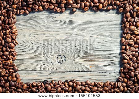 Coffee frame on wooden table as background