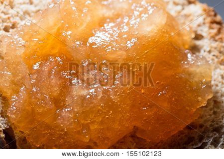 Apple jam with bubbles layered on toasted bread close up