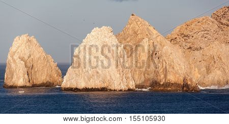 Panoramic view of eroded rocks the face of Cabo San Lucas resort town in Mexico.