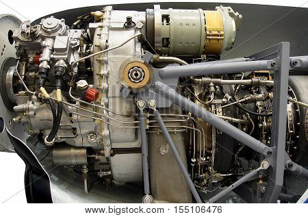 Light aircraft engine with hydraulic fuel pipes and other hardware and equipment.