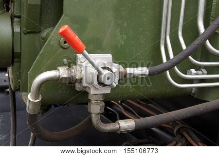 Hydraulic tubes fittings and lever on control panel of mechanism