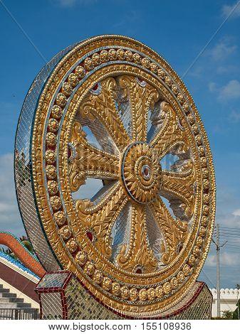 Thammachak rowel Symbols of Buddhism with sky Background.