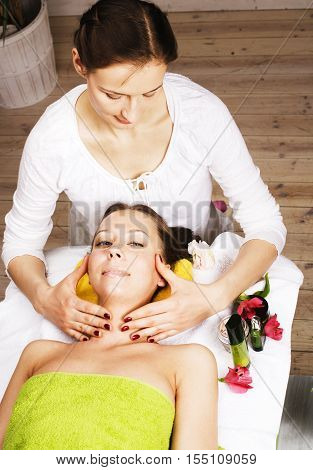 stock photo attractive lady getting spa treatment in salon, massage doctor smiling, healthcare people concept