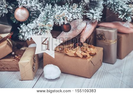 Christmas And New Year Tree Decorated Close Up. Christmas Present On White Wooden Background In Vint