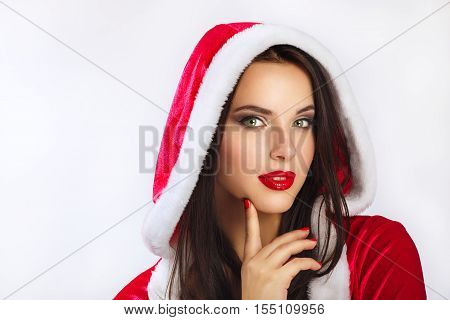 Beautiful young happy woman in Santa Claus clothes over Christmas background. Smiling woman over white background. beauty portrait . face closeup .Studio shot